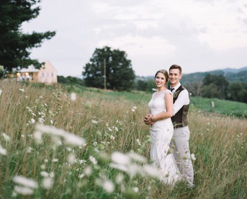 Couple having farm wedding