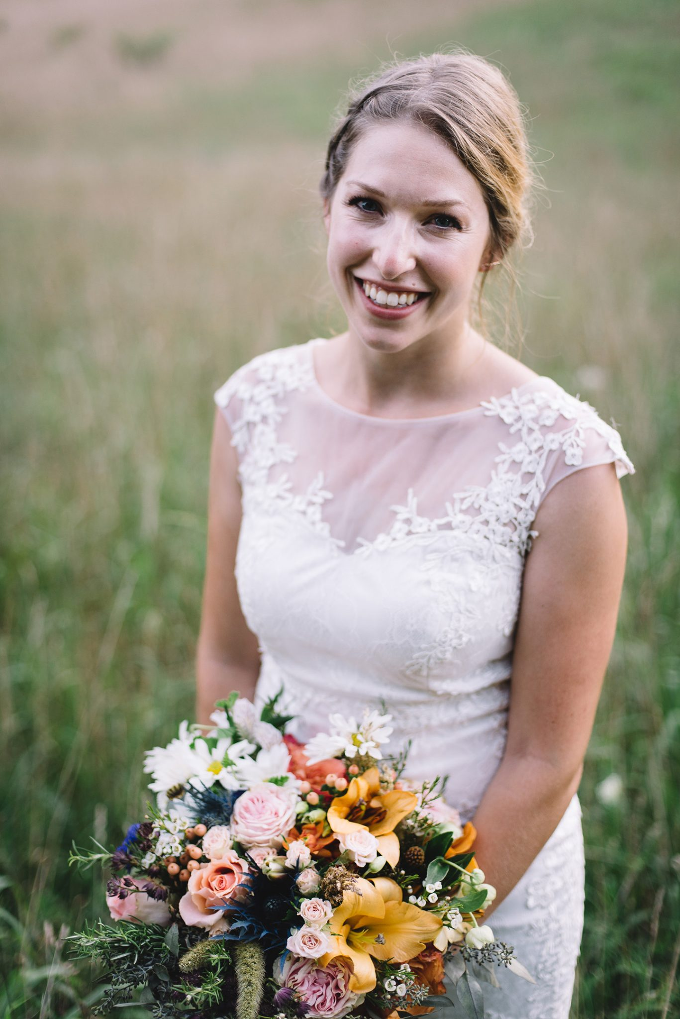 bride and flowers in field