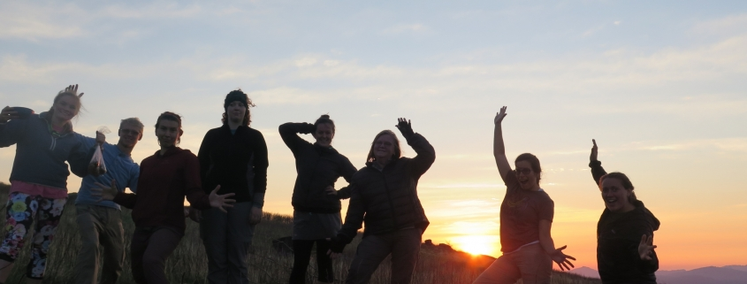 silly group pose at sunset