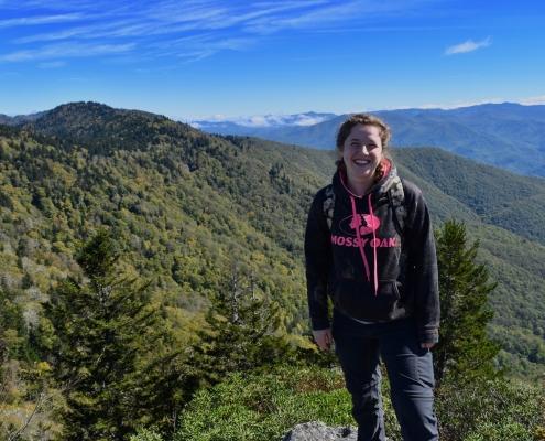 Hiker with Blackrock Mtn view behind her