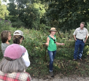 Meghan teaching about plants in pasture