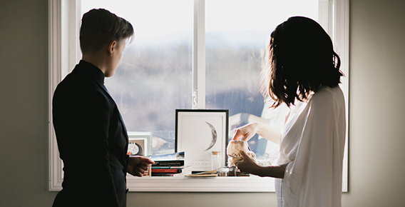 Wedding couple at window