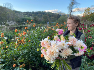 Suzanne Nolter holding flowers in scenic view
