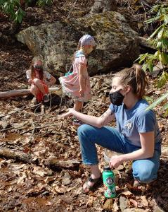 AmeriCorps Cici Wood leads students on salamander exploration