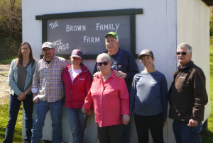 Brown family members and farmland conservation partners on site visit to farm